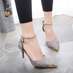 A dramatic high heels shoes, have been finished with a metal pointed head and a matching 80mm high stiletto heel. Featuring an elegant ankle strap with an adjus