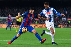 Luis Suarez of FC Barcelona competes for the ball with Diego Reyes of RCD Espanyol during the La Liga match between FC Barcelona and RCD Espanyol at the Camp Nou stadium on December 18, 2016 in Barcelona, Catalonia.