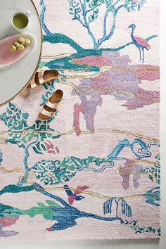 Scenic View Rug. On this scenic floor covering, cranes convene along a river while their feathered friends fly overhead.
