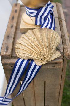 #seashells, #nautical  Photography: Stacey Hedman Photography - staceyhedman.com Planning, Styling + Floral Design: lovely little details - lovelylittledetails.com  Read More: http://www.stylemepretty.com/2013/01/28/cape-cod-wedding-from-lovely-little-details/