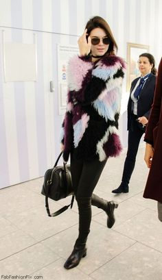 Kendall Jenner wearing fur jacket and skinny jeans at Heathrow Airport in London (December 2015). #kendalljenner
