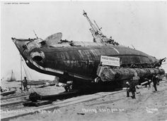 The H-3 (SS-30) is shown being moved across the sand at Somoa Beach, CA on 6 April 1917 by Mercer-Fraser Co. The caption reads: Submarine H3, April 6/17, Moving 250 ft per hr.