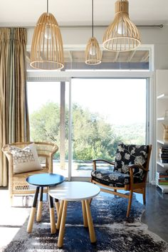 The wood pendants are made locally in Cape Town by Minima. The side tables were bought at @home. The mid-century armchair was inherited and the cane chair is from Malawi Chairs.
