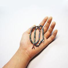 hematite gemstone bracelet (blue /  rainbow  Purple ) / designer custom jewelry 'AUGUST ALICE ' KOREA BRAND / HOMPAGE :   www.augustalice.com facebook:  https://www.facebook.com/pages/AUGUST-ALICE/1480821305483839?ref=bookmarks naver blog: http://blog.naver.com/leesdaum