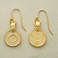 """LUNA/SOL EARRINGS--A pair of sun and moon disk earrings, in which charms of 24kt gold vermeil hand brushed to a matte finish represent night and day. The one sun, one moon earrings have vermeil French wires. 1""""L."""