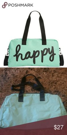 """🆕""""Happy"""" Weekender Duffle Bag Medium sized brand new mint green canvas duffle is perfect for overnight travel or the gym. Fully lined. No interior pockets. Includes detachable shoulder strap. Bag does not come with a hanging tag but includes original packaging with upc.  Approximate measurements: 18.5"""" x 0.5"""" x 12"""" with 8"""" handle drop.  Gift  with purchase. Super cute! Bags Travel Bags"""