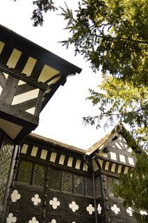 Eight minutes away from the bustling modern hub of downtown Liverpool is one of the finest surviving examples of Tudor era architecture, a manor house set amid lush gardens that feels like the middle of nowhere. Speke Hall -- http://www.picturebritain.com/2013/07/speke-hall_17.html