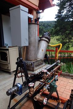 Wood gasifier for converting wood to syngas. The syngas runs a generator to power the house.