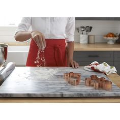 Shop French Kitchen Marble Pastry Slab. Save 10% when you sign up for emails. A Crate & Barrel exclusive, the Marble Slab helps keep dough firm while you roll and cut.
