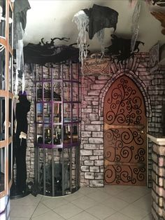 So clever! Magalie turned a regular door into a medieval style door.  And that caged shelving is inspired.  How did she do that?