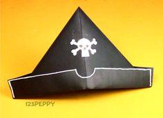 Simple folded pirate hat:  black paper, white paper, glue stick, white colored pencil