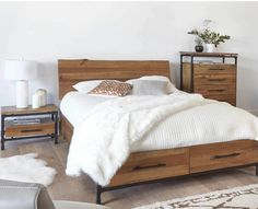 The rustic industrial Karsten platform bed offers a sleek headboard and two large storage drawers crafted from solid American poplar wood. The frame and footboard are made of powder-coated metal for dramatic contrast.