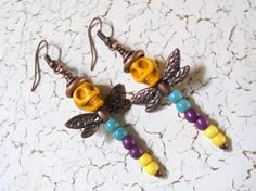 Copper Dragonflies with Yellow Magnesite Skull Heads and Turquoise, Purple and Yellow Magnesite Bodies. Earrings measure 2.