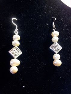 Pears with silver Celtic knot beads a classy pair of earrings!