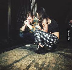 WWE's Daniel Bryan and his wife backstage moments after he announces his early retirement due to injury.