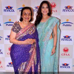Asha Parekh bonds with Rashmi Nigam during Shaina NCs show for CPAA, held in Mumbai, on May 28, 2013.