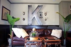 Big comfy couch with napping supplies, giant terrarium, galvanized letter. Masculine but cozy and quirky
