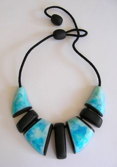https://flic.kr/p/fDH1F5 | polymer clay and ink segmented necklace |        ive been experimenting with ink ( ...well......okay......i admit. im too cheap to use ink. its food colouring lol...) and translucent polymer clay.  i covered the beads with a sheet of white clay, drippled on the colours (i added a sprinkle of salt to concentrate the colour and add variation) then baked the beads. i gently scraped off the salt once cured and covered the beads with a sheet of translucent clay.