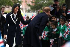 Meghan Markle Photos - Prince Harry and Meghan Markle meet local school children during a visit to Birmingham on March 8, 2018 in Birmingham, England. - Prince Harry And Meghan Markle Visit Birmingham