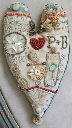 **2***///          vis           ***Heart embroidered; stiches and beads.
