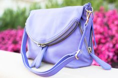 linea pelle alex messenger in violet is one of our favorites. totally chic and totally a must-have! #purple