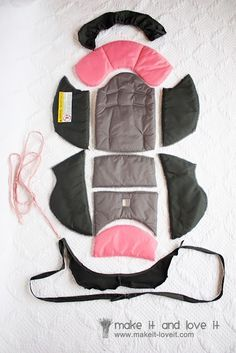 Really good tutorial for making a car seat cover. Pick apart the existing one to use for pattern. Looks like it would work good... maybe i'll atempt it, if i had the paitence ;):