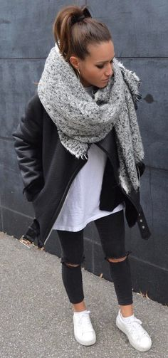 what to wear with a leather jacket : scarf + white top + rips + sneakers