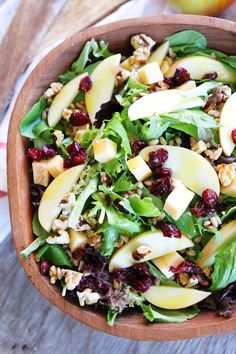 Apple, Gouda, and Farro Salad with dried cranberries, toasted walnuts and an easy apple cider dressing is the perfect salad for fall! #apple #salad