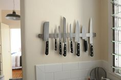 if you want an industrial look and you don't like that knife blocks take up so much counter space, here's a great way to display those blades!