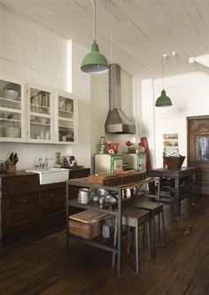 By Gardener & Marks. In all of their designs, they nail the perfect mix of modern and vintage, chic and shabby. This old-school industrial style kitchen is an example.