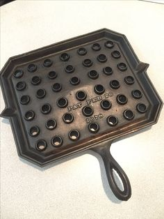 Unmarked square broiler.  Bottom gated.  Patent Feb 26, 1878  A smaller size and a round broiler are shown on this page.