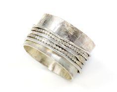 HAMSA Ring. Sterling silver wide filigree band via Etsy.