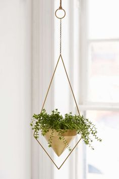 Love the diamond shape of this Boho geometric, gold hanging planter from Urban Outfitters.