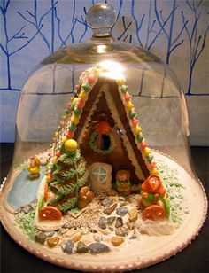 ginger bread house under glass (the only way this would work in a house with cats and the occasional ant... :)