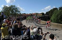 The leading riders pass over the bridge in West Tanfield, Yorkshire during the 2014 Tour de France.