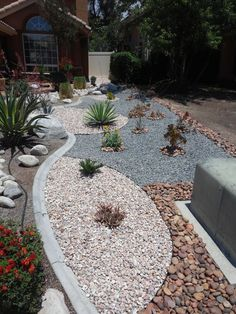 Water-wise front yard landscaping project in Temecula, California with Gambler's Gold pink crushed rock, gray crushed rock, and Premium Sunburst Pebbles bought from Southwest Boulder & Stone. Plants are lantana, yucca and kangaroo paw. #landscapingprojects