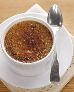 Espresso-Creme-Brulee-1 1/4 cups heavy cream 1/3 cup whole milk 1/2 cup granulated sugar 4 ounces (1/2 cup) prepared espresso 1 vanilla bean, split lengthwise 7 large egg yolks 2 tablespoons turbinado or raw sugar