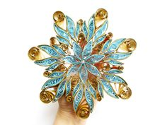 my quilling snowflake on my own hand :) by othewhitewizard on DeviantArt