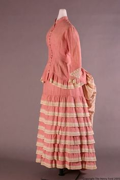 This 1880-1882 summer day dress is wonderful as it is a middle class rendition of Parisian high fashion. Chances are it still would have been a Sunday best type of dress, but it is so rare to find antique clothing that normal people would have worn.