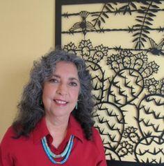 Carmen Lomas Garza with metal cutout artwork