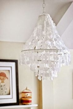 {DIY} Faux Capiz Shell Pendant - The Chronicles of Home. This could be adapted to make a jelly fish light for the guest bath