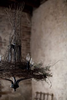 rustic chandelier - adding grassy/earthy foliage as texture could be interesting