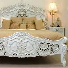 ornate bed headboard, footboard, white  interior, bedroom