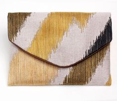 Green zigzag Lolie envelope clutch.