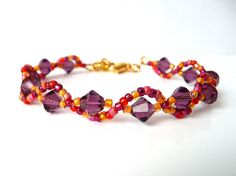Beaded Jewelry Bracelet Swarovski Crystal by MelJoyCreations Swarovski amethyst crystals blended with Japanese seed beads in rich tones of gold, amber, orange and amethyst are hand woven with Fireline for strength and durability and made to last. The bracelet is finished with a gold plated swivel lobster clasp, a gold plated heart charm and a 1/2 inch extension for adjustable sizing.