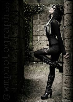 Love everything about this photo. Pretty Gothic fashion, pretty hair and model has a great body and pose