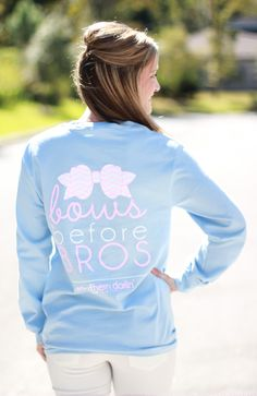 """Southern darlin' collection is a southern lifestyle brand. This light pink long sleeve tee features """"Bows before bros"""" back design. Front features the Southern darlin' logo with anchor. Model is 5..."""