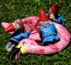 Zombie gnomes eat a lawn flamingo.... I want one.