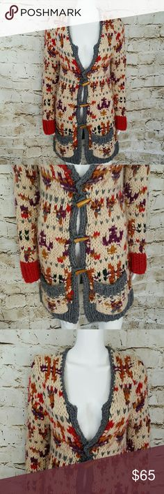 """Anthropologie Sleeping on Snow sweater coat Beautiful sweater coat of many colors!  Perfect sweater for Spring still a little chill in the air.  Chunky knit with red cuffs and 2 front patch pockets wooden horn buttons.  19"""" across from armpit to armpit and 32"""" long from shoulder to hem Anthropologie Sweaters"""