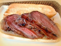 Santa Maria Style Tri-Tip.  Rubbed with lots of fresh garlic and olive oil and some salt...then slow cooked with oak chips.  You don't need sauce for this-- so good! My personal favorite.